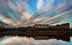 GPRC (wrighteye) Tags: canada alberta canon reflection sky clouds water building brick college grandeprairie longexposure
