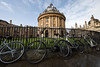 Ultra wide Oxford. (James Thomas 10375) Tags: oxford city fence bicycles university campus radcliffe square camera library bodleian ultra wide sigma1224f4dghsmart heritage england united kingdom canon spires angle low perspective
