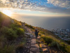 Hiking the Lion's Head (TeunJanssen) Tags: travel traveling backpacking africa southafrica capetown olympus omd omdem10 hike lionshead goldenhour sunset walk view landscape sun lensflare hill signalhill 918mm