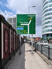 UK roadsign design mess. (Tim Kiser) Tags: 2017 20170810 a56 a56road a6 a6road a665 a665road august august2017 england greatbritain img5255 m62 m62motorway manchester manchesterengland manchesterinnerringroad manchesterringroad manchestercitycenter manchestercitycentre northwestengland ringroad ringroadsign uk unitedkingdom biggreensign citycenter citycentre directionalroadsign directionalsign fence greensign highwaysign intersectionmap map mapofanintersection northernengland northwesternengland parentheses partlysunny paved pavement railing roadsign sidewalk tobury tocheethamhill toliverpool tosalford txtchg