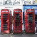 Three of a kind: red phone boxes, Cheltenham Spa, UK