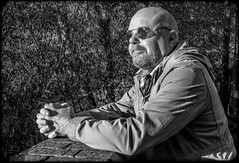 Enjoying the sun. (CWhatPhotos) Tags: cwhatphotosblack white portrait sunglasses shades man male face olympus omd em10 digital camera photographs photograph pics pictures pic picture image images foto fotos photography artistic that have which with contain black mono monochrome look sun light natural
