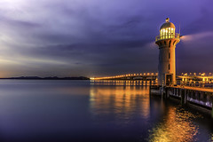 Raffles Marina Lighthouse (~trigger_happy~) Tags: rafflesmarinalighthouse longexposre bluehour wideangle 1740mm canon5d ndfilter reflection golden glow