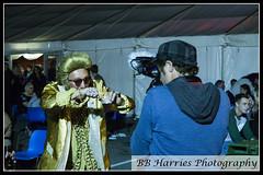Elvis Festival 2017 (Ben Harries) Tags: streetportraiture streetphotography music portraiture portrait portraits porthcawl porthcawlseafront elvis festival elvisfestivalporthcawl elvisfestival gold camera cameraman rings jewlery hitide hitideporthcawl tent carpark photo photographer photograph pose poser posing bridgend southwales wales party night nightphotography nightshots nightshot