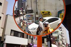 Shinagawa sanpo moment (Eric Flexyourhead) Tags: shinagawa shinagawaku 品川区 tokyo 東京 japan 日本 oldtokaido oldtokaidoroad 東海道 city urban detail fragment parkinglot mirror reflection friends photographers me selfie sun sunshine bright sonyalphaa7 zeisssonnartfe35mmf28za zeiss 35mmf28