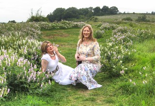 Shepherdesses at rest amidst a sea of vetch