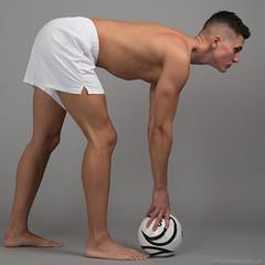 Dominic (PhotoMechanic.uk) Tags: male man guy dude youth model pose photoshoot boy studio sport football footballer ball penalty shirtless topless shorts white foot feet barefoot