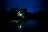 (Jack R. Seikaly Photography) Tags: guilinshi guangxizhuangzuzizhiqu china cn fisherman blue sky hour twilight portrait cormorant fishing reflection bird lamp glow jack seikaly photography person man bamboo raft