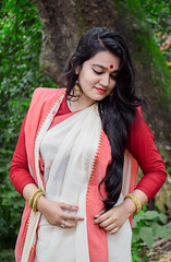 Antara (MashrikFaiyaz) Tags: portrait tree plants green background morning natural light sunlight sweet gentle mild nikon d5300 flickrunitedaward festival saree getup outlook red white face hair lips posing happiness smiling smile colors colorful ornaments outdoor dhaka asia southasia bangladesh september autumn cute beautiful fairness glamour gorgeous