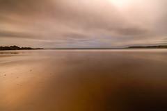 "golden evening light flows across the magnificent sweep of Cullen Bay, Cullen, Moray, Scotland, UK. long exposure. (grumpybaldprof) Tags: ""fineart"" ethereal striking artistic interpretation impressionist stylistic style golden goldenlight evening magnificent cullen ""cullenbay"" 1153 moray scotland uk waves beach sand rock village ""northsea"" seagulls harbour fishing ""cullenskink"" ""fishsoup"" bay sea northsea longexposure neutraldensity soft tones canon 7d ""canon7d"" sigma 1020 1020mm f456 ""sigma1020mmf456dchsm"" rocks cliffs wideangle ultrawide"