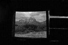 Cunningham Cabin (Joy Forever) Tags: grandteton tetons grandtetonnationalpark wyoming mountain rockymountains nationalpark usa film 35mm 35mmfilm ilford ilforddelta400 blackwhite blackandwhite bw mx pentax pentaxmx window cabin cunninghamcabin