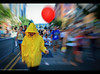 You'll float too for Halloween - San Diego Comic Con 2017 (Sam Antonio Photography) Tags: sandiegocomiccon cosplayer movie balloon female walking scary horror samantoniophotography it streetphotography gaslamp halloween red yellow blurredmotion stephen king novel pennywise
