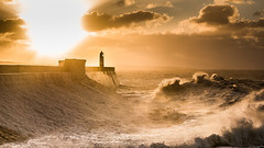 Sunrise over Porthcawl Lighthouse (Nathan J Hammonds) Tags: sunrise sea wave harbour wall lighthouse porthcawl wales uk britain seascape morning nathan hammonds photography clouds nikon d750 70200 tamron backlight