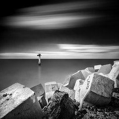 Cadzand Abstraction IV (Alec Lux) Tags: bw beach blackandwhite blackandwhitephotography blocks breakwater cadzand coast coastline entrance groyne harbour landscape landscapephotography lighthouse longexposure longexposurephotography marine nature naturephotography netherlands ocean port rocks sand scenic sea seascape seascapephotography sky smooth stones water waves zeeland nl