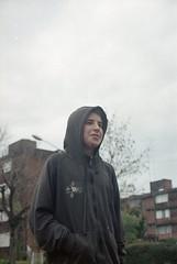 encapuchado (flotan te) Tags: lluvia rain durazno uruugay kid youth analogue 35mm 35mmfilm film filmisnotdead analoguevibes onfilm bike boy