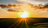 Sunrise Flare (Andy.Gocher) Tags: andygocher canon100d canon100dsigma18250 europe uk wales westwales southwales pembrokeshire coastalpath sunrise landscape sun flare clouds cloudscape sunburst