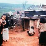 Ben Het 1969 - Vietnamese Woman and Children After Surviving Enemy Siege - Photo by Shunsuke Akatsuka thumbnail