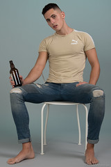 Dominic (PhotoMechanic.uk) Tags: male man guy dude youth model pose photoshoot boy studio beer bottle jeans tshirt fashion trendy casual green blue chair foot feet barefoot sit sitting