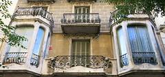 Barcelona Oriels (Spencer Means) Tags: architecture building house window oriel bay balcony railing iron ironwork wrought shutters facade façade modernista modernisme dreta eixample barcelona catalonia catalunya spain balcón balkon