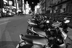 Bikes (superzookeeper) Tags: 5dmk4 5dmkiv canoneos5dmarkiv ef2470mmf28liiusm eos digital taiwan hsinchu blackandwhite bnw monochrome tw bike motorbike motorcycle night moped over1000views street