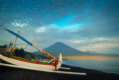 Mt. Agung, Bali (EdBob) Tags: bali mtagung gunungagung agung volcano mountain amed sunrise jukung beach danger shore volcanic dawn blacksandbeach indonesia eastbali indonesiantravel indonesian mt clouds sky asia asiatravel water ocean jemeluk shoreline sea eruption fishingboat fishing outrigger sailboat sail colorful color edmundlowephotography edmundlowe asian allmyphotographsare©copyrightedandallrightsreservednoneofthesephotosmaybereproducedandorusedinanyformofpublicationprintortheinternetwithoutmywrittenpermission boat