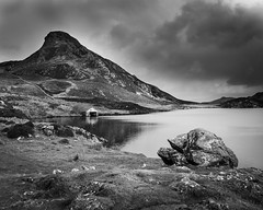 Llyn Cregennen (Alan Hughes Mach) Tags: cymru wales eryri snowdonia snowdonianationalpark llynnaucregennen cregennen caderidris cadairidris arthog dolgellau gwynedd lake water boathouse mountain summit hill hike hiking walk walking landscape landschaft paysage rural countryside scenery mountainside monochrome mono blackandwhite bnw bw sky cielo clouds himmel rock dof depthoffield fishing natural ciel noiretblanc canon november autumn light outside outdoors outdoor blackwhite black grey white stone storm natur naturaleza automne wasser shore sunlight reflection path paisaje nature welsh uk blancoynegro