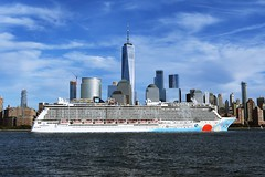 The cruise ship Norwegian Breakaway sails past the One World Trade Center and Lower Manhattan on its way to the Bahamas (Paul Anthony Moore) Tags: cruiseship norwegianbreakaway oneworldtradecenter lowermanhattan newyork bahamas newjersey