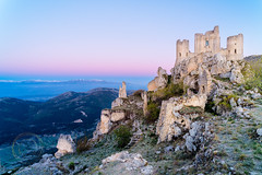 Rocca Calascio (Simone Della Fornace) Tags: italy roccacalascio castle fortress rocks mountains sunrise hiking ruins green moss pink blue outdoor hills viewfromabove nopeople nobody serene wide voigtlander 21mm sony a7rii landscape travel traveldestination tourism touristicdestination landmark building architecture