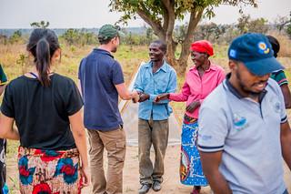 WorldFish staff meeting the community, Zambia. Photo by Chosa Mweemba.