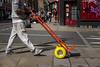 yellow wheels (Silver Machine) Tags: streetphotography street man trolley walking road pavement outdoor 3rdannualstreethuntersmeeting streethunters fujifilm fujifilmxt10 fujinonxf35mmf2rwr