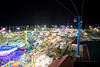 seeing the lights from above (ezeiza) Tags: oklahoma ok tulsa tulsastatefair state fair statefair vonrollskyride vonroll skyride gondola aerialtramway aerial tramway cablecar cable car gangloff midway northamericanmidwayentertainment amusement rides rollercoaster roller coaster ferris wheel