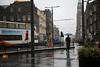 rainy Edinburgh (Dieter Drescher) Tags: edinburgh regen rain regnerisch rainy wetter weather pfützen puddles mann man regenschirm umbrella bus oberleitung overheadwiring strase street bürgersteig pavement kirche church lampen lamps lampenmasten lampposts dieterdrescher