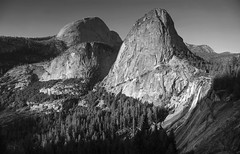 Three mountain tops at Yosemite (PeterThoeny) Tags: johnmuirtrail halfdome mtbroderick libertycap yosemite yosemitevalley yosemitenationalpark california nationalpark mountainside mountain rock cliff granit landscape day dusk clear sky monochrome blackandwhite 1xp raw sony nex6 selp1650 photomatix hdr qualityhdr qualityhdrphotography fav200
