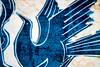 Blue Bird of Happiness (San Francisco Gal) Tags: macromondays souvenir malaysia wood tile carving bird bluebird bluebirdofhappiness macro