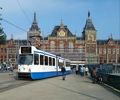 Amsterdam Central Station (stardex) Tags: amsterdam centralstation building architecture transport tram vehicle netherlands holland sky heritage