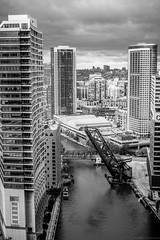 Kinzie Street Bridge (Fret Spider) Tags: architecture chicago river sky cloud weather openhouse foundation ebc riverbend manual ze canoneos5dsr monochrome blacknwhite blackandwhite skyline water building reflection kinziestreet chicagosuntimes manuallens
