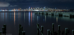 Vancouver Nightscape (Robert Henrickson) Tags: vancouver lonsdalequay nightscapes cityscapes skyline wetreflections oceanblue seaside burrardinlet lonsdalepier longexpoosure panorama pacificnorthwest ilovebc canadaplace discoverbc