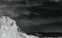 Ophelia engulfing the lighthouse (Tim Bow Photography) Tags: stormophelia dramaticseascape dramatic sea water wales porthcawl lighthouse pier timboss81 timbowphotography ukwildweather storm storms ukstorms adventure outdoor windy violent hurricane ophelia mood ominous blackandwhiteseascape large waves