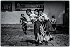 Portrait # 5 (bertranddorel) Tags: enfants noiretblanc bn bnw blackandwhite bali indonésie ecole groupe cours human street children girl school light bw portrait people friend walking day face kids asia mono me city flickr nikkor nikon analog nb