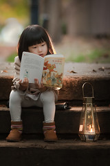 eternal  light (michaelinvan) Tags: autumn fall child girl reading book candle lantern stairs backlit light canon 5d mark2 135mm f2 leaves leaf goilden hour dusk richmond chinese words boots warm cold color orange blue green bokeh dof alley road