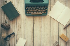Type writer on wooden table (Wallboat) Tags: book commoncreativeimages desk freeimages freephotos glasses notebook office read royaltyfree table typewriter work write