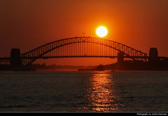 Harbour Bridge @ Sunset, Sydney, Australia (JH_1982) Tags: harbour bridge puente ponte baía bahía 雪梨港灣大橋 ハーバーブリッジ 시드니 하버 브리지 харборбридж cầu cảng สะพานซิดนีย์ฮาร์เบอร์ सिडनी बंदरगाह पुल sky evening yellow orange red sun glow sydney sídney 悉尼 シドニー сидней nsw new south wales australia australien australie 澳大利亚 オーストラリア 오스트레일리아 австралия sunset ocaso sonnenuntergang coucherdesoleil pôrdosol tramonto закат zonsondergang zachódsłońca solnedgång solnedgang auringonlasku apus залез matahariterbenam mặttrờilặn 日落 日没 غروب harbor hafen brücke silhouette silhouettes reflection reflections landmark building steel famous water architecture engineering