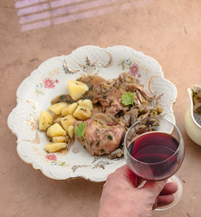 Coq au vin with potatoes, sauce and red wine. (annick vanderschelden) Tags: fillet filet cut slice boneless meat bird chicken mainportion breast food kitchen gastronomy cuisine nutrients preparation poultry unsaturatedfat proteins cooking skin legquarter leg wings cuts leek bacon turkey oliveoil onion mushroom both bay bayleaf butter flour pepper thyme cilantro salt lid bowl decorative coqauvin sauce parsley pressurecooking cooked served readytoeat pottery