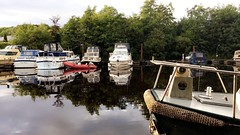 (staceygallagher2) Tags: stillphotography stillwater reflections scenic boardwalk water lake dock boats boat