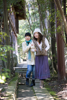 Japanese sisters walking in bamboo forest