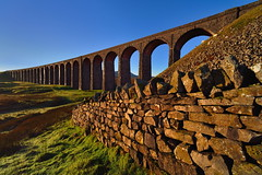 Dawn arches (images@twiston) Tags: dawnarches twenty four sunrise ribblehead viaduct ribbleheadviaduct settle carlisle settlecarlisle yorkshire northyorkshire classic iconic dry stone wall warm tones ingleborough midland railway main line 1875 battymoss battywifehole sebastopol belgravia jericho scheduledancientmonument 24 arch arches ribblesdale dales 3peaks yorkshire3peaks imagestwiston golden dawn morning national park yorkshiredalesnationalpark fields grass farmland moorland moor blue sky cloudless clear landscape twentyfour fells manmade stonework godsowncountry architecture nofilters nikon14mmf28 nikkor14mmf28 nikonafnikkor14mmf28d 14mm ultrawide superultrawide ultraultrawide ultra wideangle wide angle