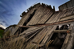 Center of Gravity (drei88) Tags: cursed barn forlorn bleak dreary grim shattered desolate cloudy windy dark shadow light energy atmosphere legend myth charged searching discovery memories facade rural farm dairy historic opportunity reaching d7k d7000 brooding looming precarious collapse neglect lightning