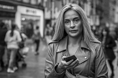 Getting The Message (Leanne Boulton) Tags: portrait people urban street candid portraiture streetphotography candidstreetphotography candidportrait streetportrait eyecontact candideyecontact streetlife mobile phone technology message woman girl female face facial expression blonde hair eyes look emotion feeling mood tone texture detail depthoffield bokeh naturallight outdoor light shade shadow city scene human life living humanity society culture canon canon5d 5dmkiii 70mm ef2470mmf28liiusm black white blackwhite bw mono blackandwhite monochrome glasgow scotland uk