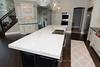 Thick Quartz Island (ArchCityGranite) Tags: entry way kitchen island quartz pendants wood floors double oven stainless steel appliances