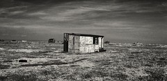 Whit hut in landscape dungeness with boat on horizon ($teveH) Tags: